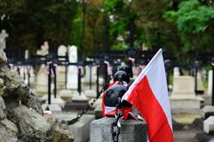 Small Polish flag on the old cemetery. National memory day concept. Royalty Free Stock Photos