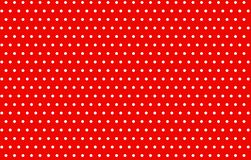 Small polka dots on red background. Small polka dots red background vintage new art print fabric plaid creative design graphic backdrop simple cloth dress shirt stock photo