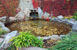 Small pond in autumn city park Stock Photo