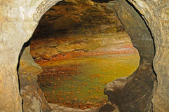 Small pond through a cave opening Stock Photos