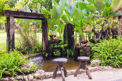 Small pond and garden Stock Images