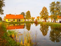 Small pond in the middle of Holasovice - traditional Czech village, Czech Republic. UNESCO World Heritage Site.  stock photos