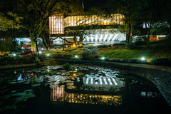 Small pond and modern buildings at night, from Hong Kong Univers Royalty Free Stock Photography
