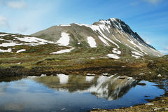 Small pond with mountain reflected Stock Images