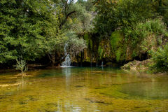 A small pond with a small waterfall Royalty Free Stock Photography