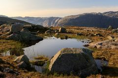 Small pond on the track to Trolltunga, in a beautiful landscape in Odda, Norway stock photos