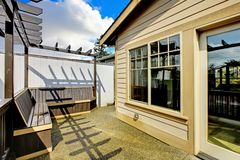 Small porch with benches in the back of the house. Stock Photo