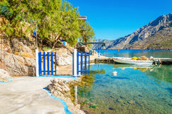 Small port with blue wooden gate, Greece Stock Photo