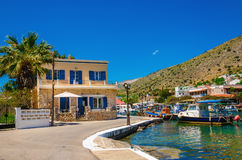 Small port with colorful boats, Greece. Small port with colorful boats and typical Greek house, Greece Stock Photos