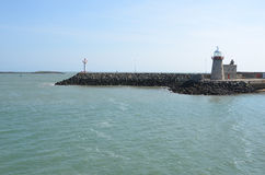 Small port on Howth peninsula in Ireland with lighthouse Royalty Free Stock Photo