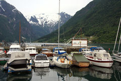 Small port near snow mountains. Small port near a near snow mountains in Norway Royalty Free Stock Photos
