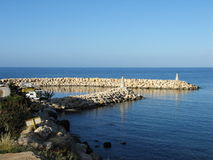 Small port, neverending sea. The port and sea of Pomos, Cyprus royalty free stock photo