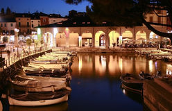 Small port at night royalty free stock photography