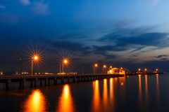 Small port ship and reflect lamp in night time. At Sattahip , Thailand Stock Photos
