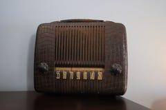 Small brown portable vintage radio. A small portable hand held vintage radio. An old brown leather radio stock image