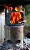 Small portable wood stove. Fire in small portable wood stove royalty free stock photo