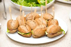Small portioned sandwiches in the cafe. Self-service table Stock Image