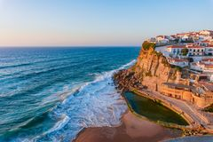 Small Portugal village Azenhas do Mar on cliff on coastline, near Lisbon with a beautiful sunset. Portugal, landscape, atlantic, blue, europe, ocean, scenic stock photos
