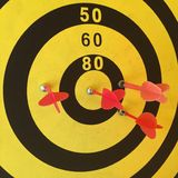 Dart board with red arrow Royalty Free Stock Image