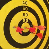 Dart board with red arrow Stock Image