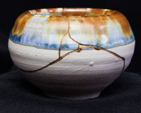 Kintsugi Pot. A small pot repaired using the Japanese art of kintsugi joinery with gold. The art form is between 400-600yrs old royalty free stock images