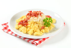Small potato dumplings with bacon and cabbage Royalty Free Stock Photos