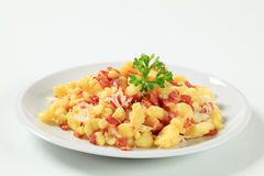 Small potato dumplings with bacon and cabbage Stock Images