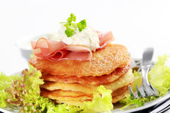 Small potato pancakes with salad Royalty Free Stock Photos
