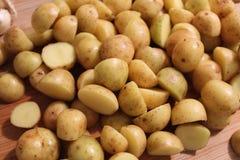 Small potatoes cut in half Stock Photos