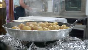 Small potatoes fried on silver pan in the restaurant stock video footage