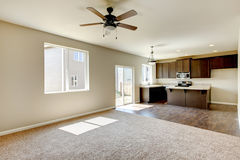 Small yet practical kitchen with brown cabinets and hardwood flooring. Royalty Free Stock Photos