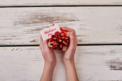 Small present box in hands. Stock Images