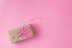 Small present in recicled craft pape Royalty Free Stock Photography