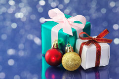 Small presents on blue sparkle background. Stock Photography