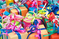 Small presents tied with bows. Royalty Free Stock Image