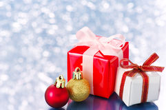 Small presents on white sparkle background. Royalty Free Stock Images