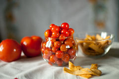 Small preserved cherry tomatoes in a glass vase Royalty Free Stock Image