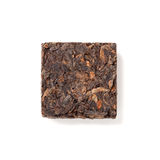 Small pressing briquette of black Chinese Shu Pu-erh tea Royalty Free Stock Photo