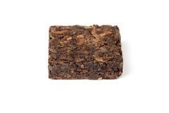 Small pressing square briquette of black Chinese Pu-erh tea Stock Photos