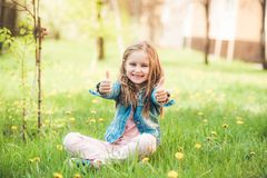 Small preteen girl enjoying summer days stock photo