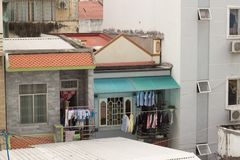 Small but pretty apartments in poor asian city. Some clothes hunged up to dry on the balcony royalty free stock photo