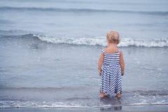 Small pretty baby girl walking along seashore Royalty Free Stock Photography