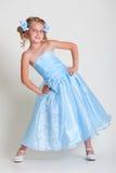 Small pretty model in blue dress Stock Photo