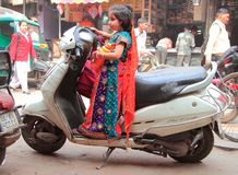 Small princess drive motorbike in Delhi Royalty Free Stock Photos