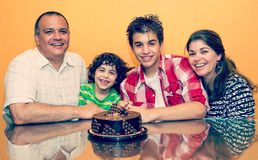 Small Private Birthday Party. Small private birthday celebration of a Hispanic family at  home. Two generations together Stock Photos