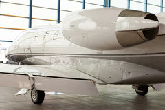Small private corporate jet in a hangar Royalty Free Stock Photo