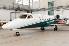 Small private corporate jet in a hangar Stock Images