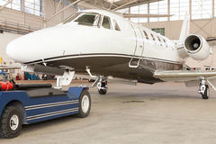 Small private corporate jet in a hangar Royalty Free Stock Image