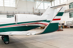 Small private corporate jet in a hangar Royalty Free Stock Photos