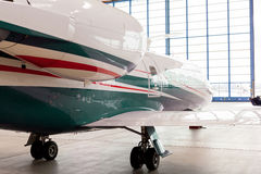 Small private corporate jet in a hangar Royalty Free Stock Images